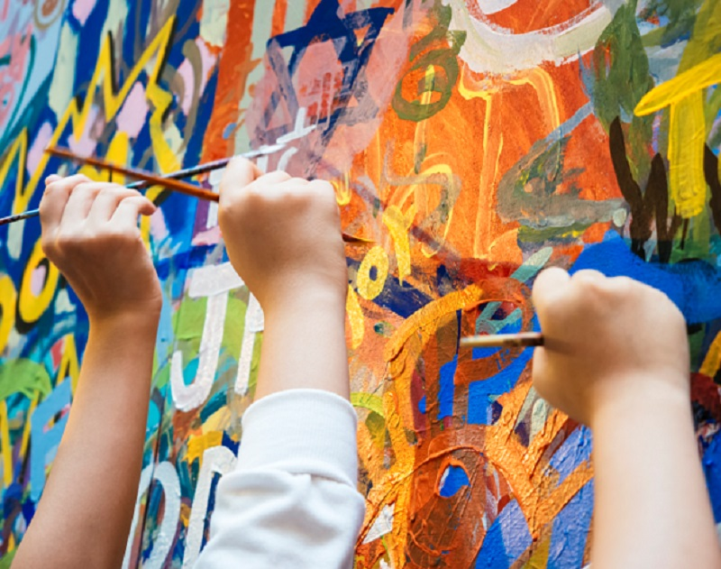 Kids Painting on Wall